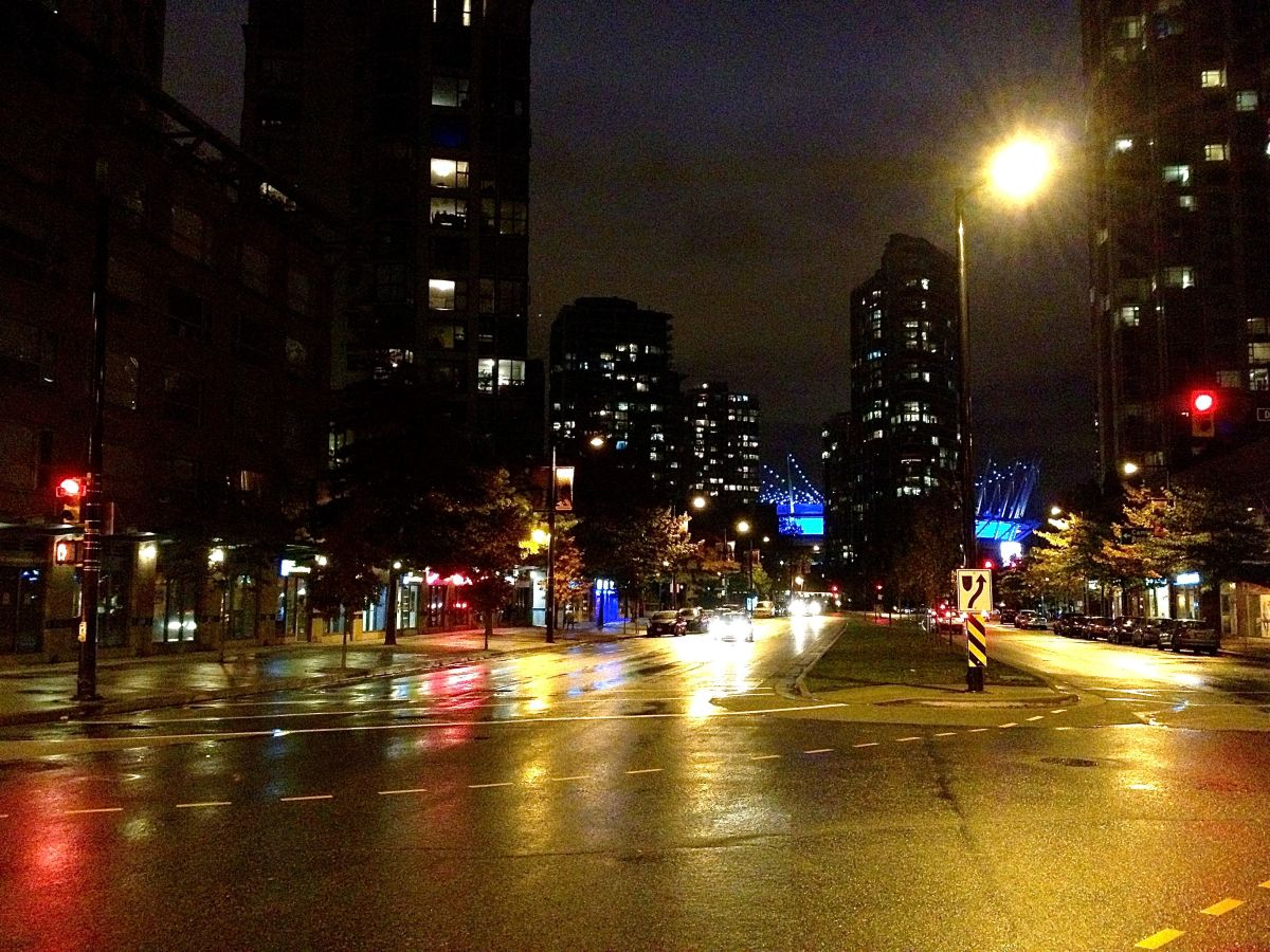 Yaletown at night. BC Place Stadium is visible in the distance (look for the blue lights!).