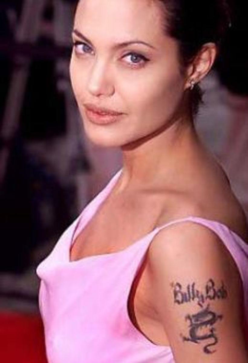 "Originally, Angelina had a tribal dragon on her left upper arm. Then she added ""Billie Bob"" for her second husband."