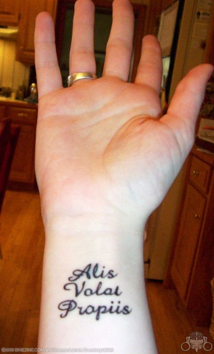 "Alis volat propriis (misspelled in tattoo): ""She/he flies by her/his own wings."""