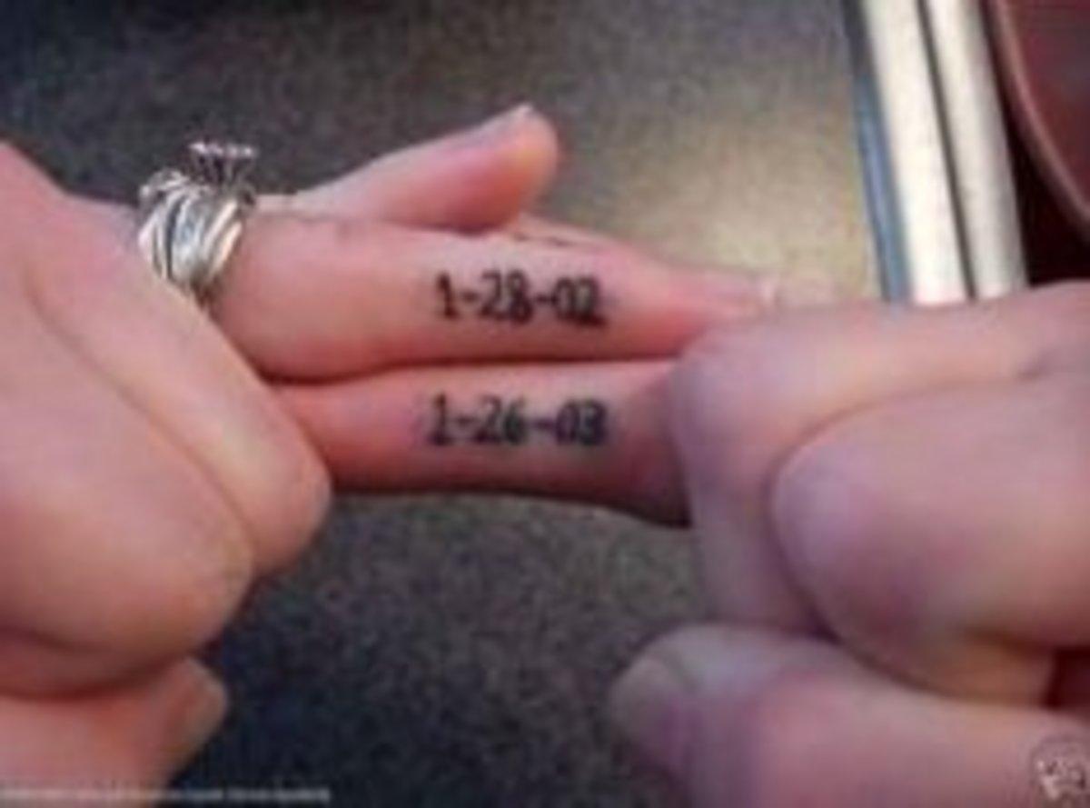 Tattoo ideas wedding ring finger tattoos tatring for Wedding ring finger tattoos