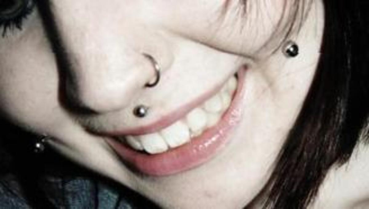 Cheek piercings (and a nose ring and Medusa piercing).