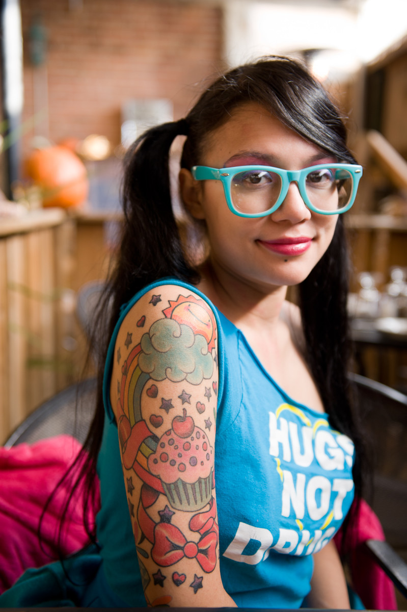 A woman with a colorful cupcake tattoo.