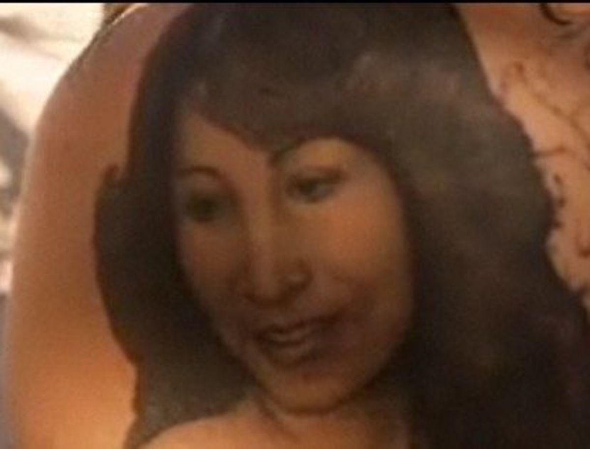 Portrait of her mom on her left shoulder