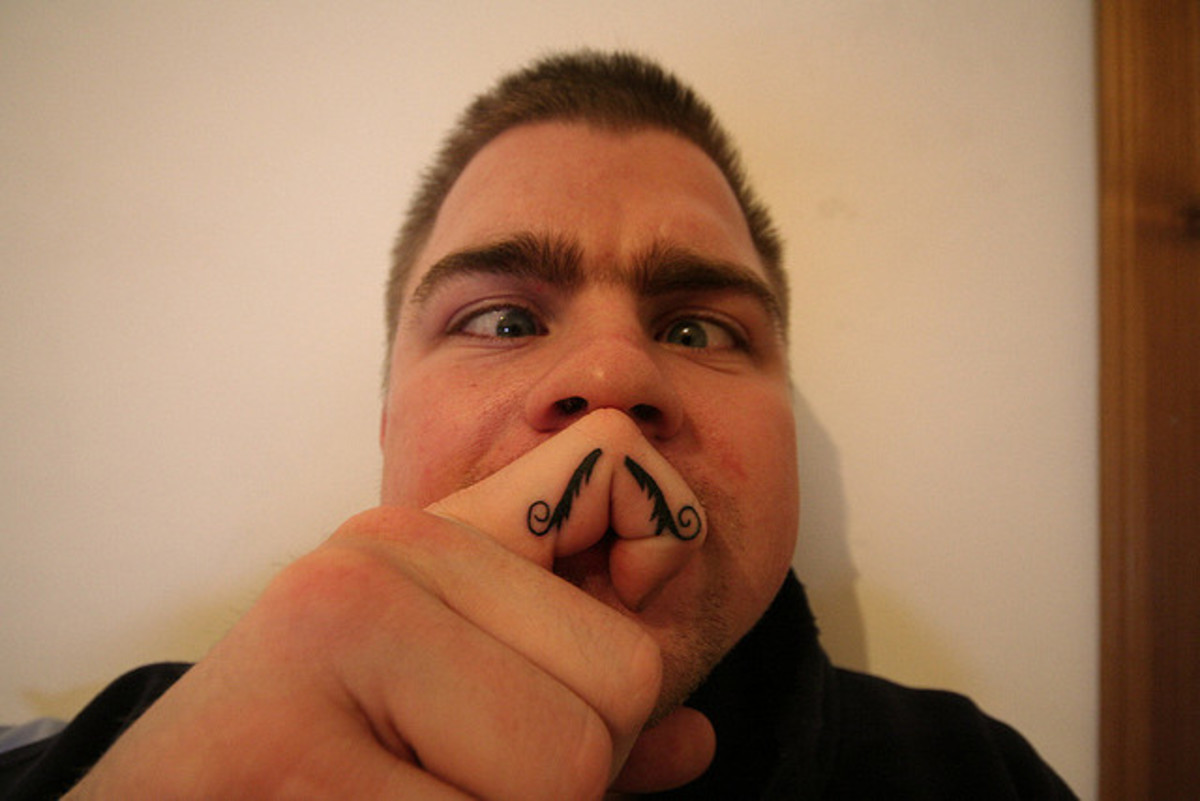 "someone making a funny ""fingerstache"""