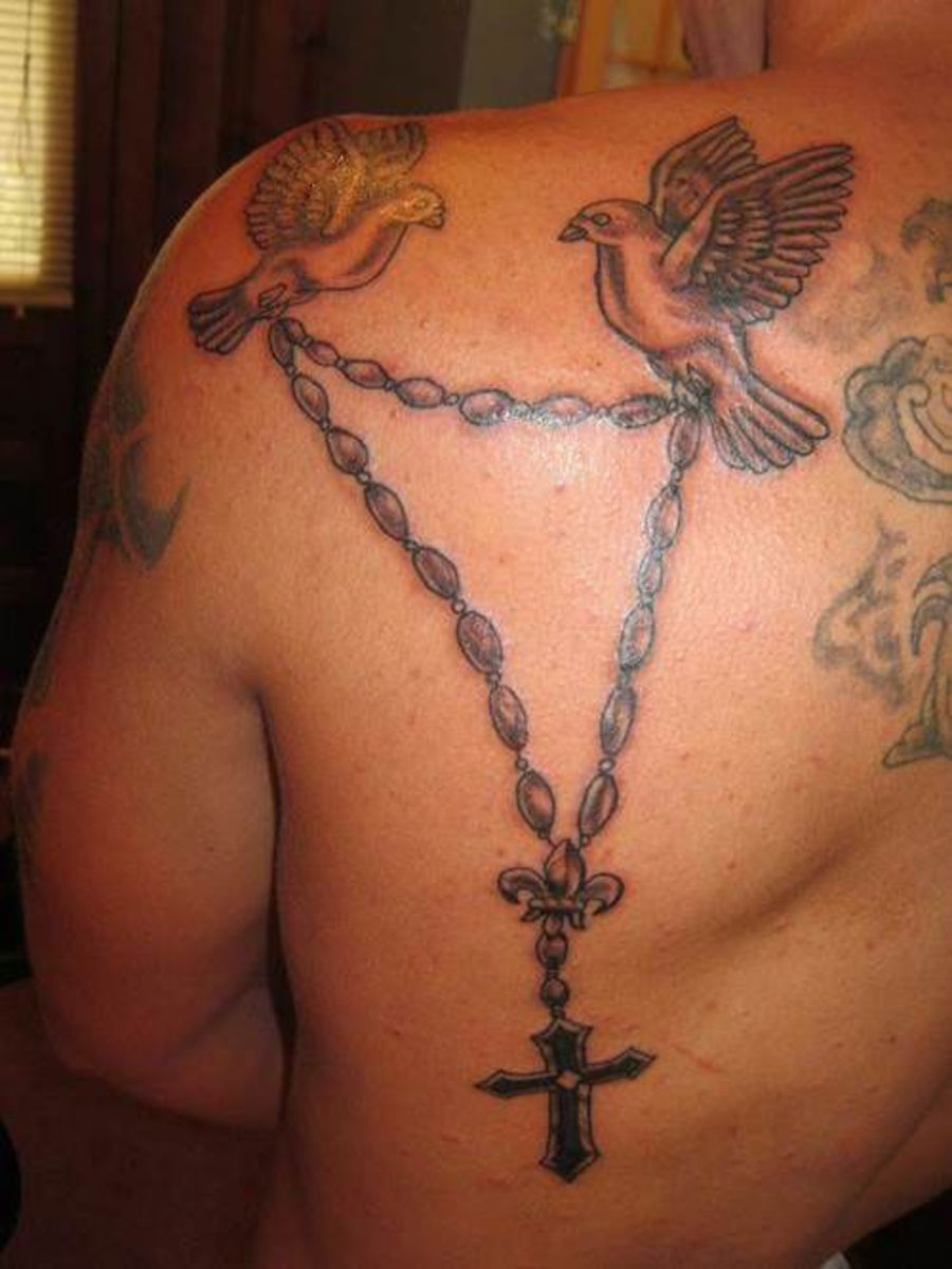 Rosary and dove tattoo