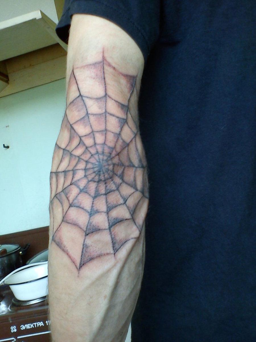 Spiderweb Elbow Tattoo