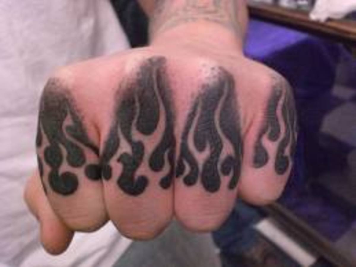 Flame tattoos on the knuckles.