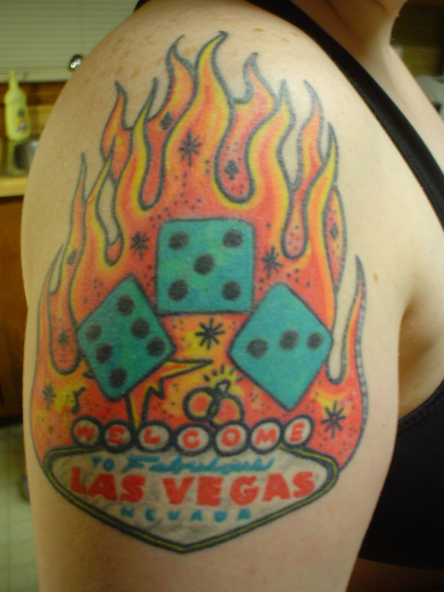 A fiery Las Vegas tattoo with flames and dice.