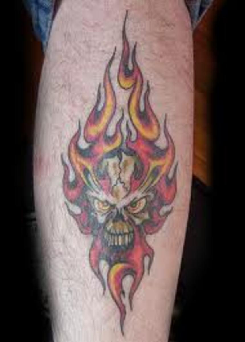 A flaming skull tattoo.