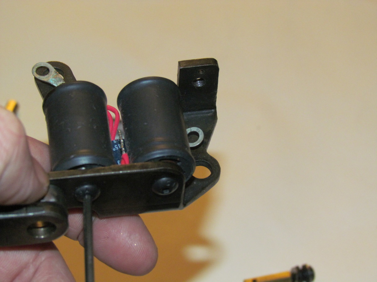 Remove the screws from the coils.