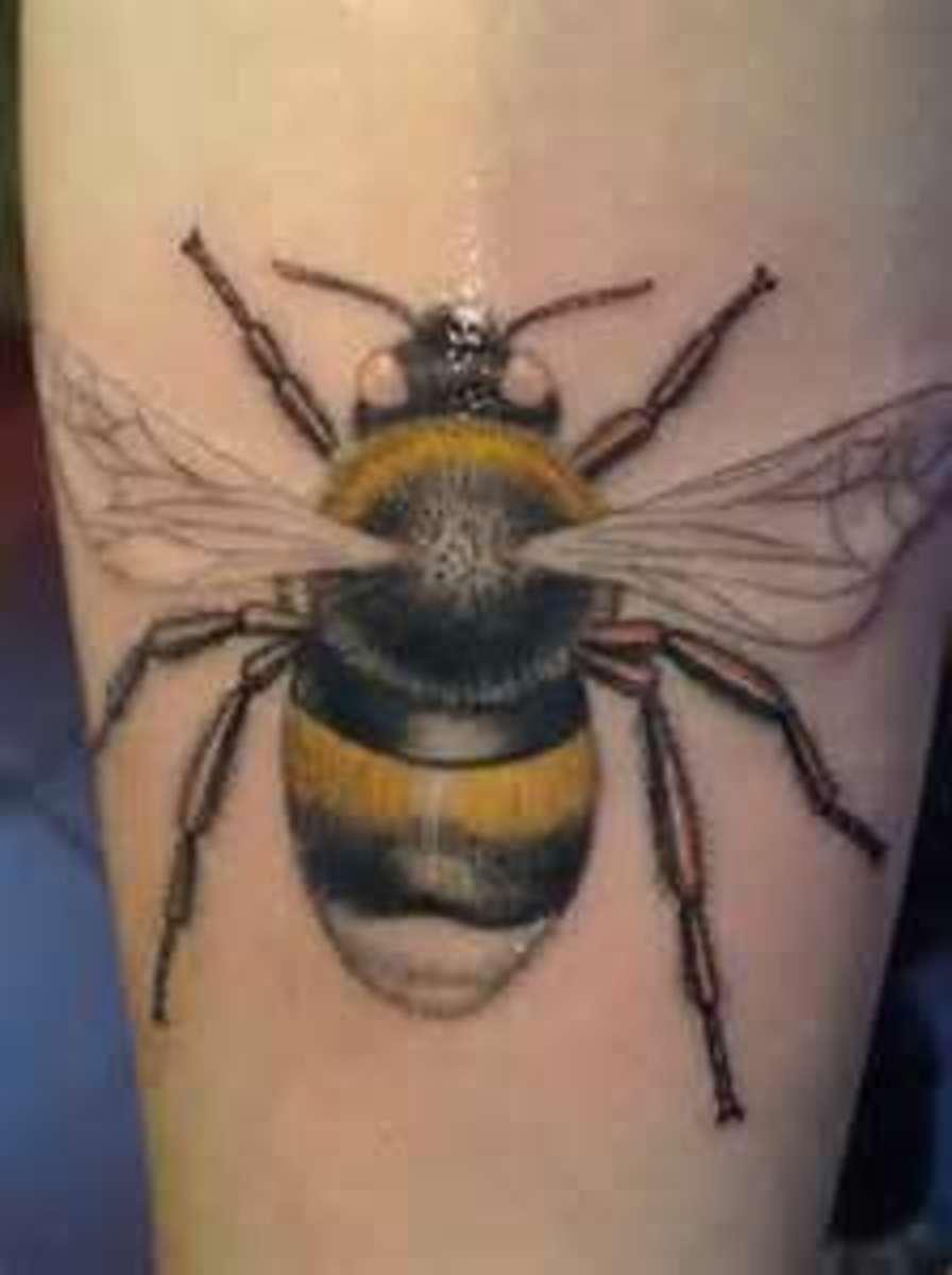 A realistic tattoo of a single bee.