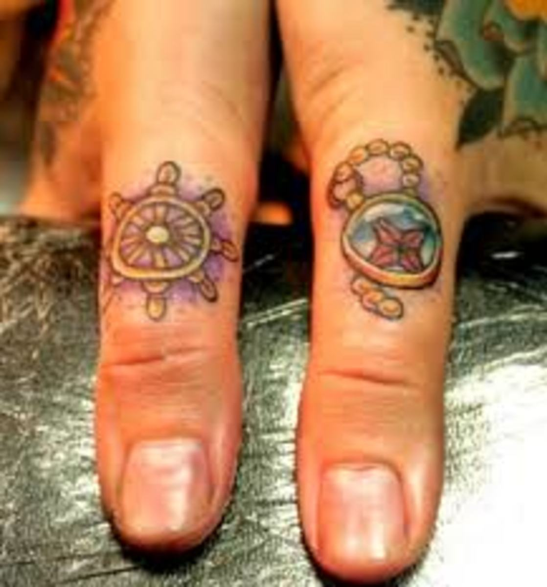 Very ornate thumb tattoos. Wonder how these will stand the test of time.