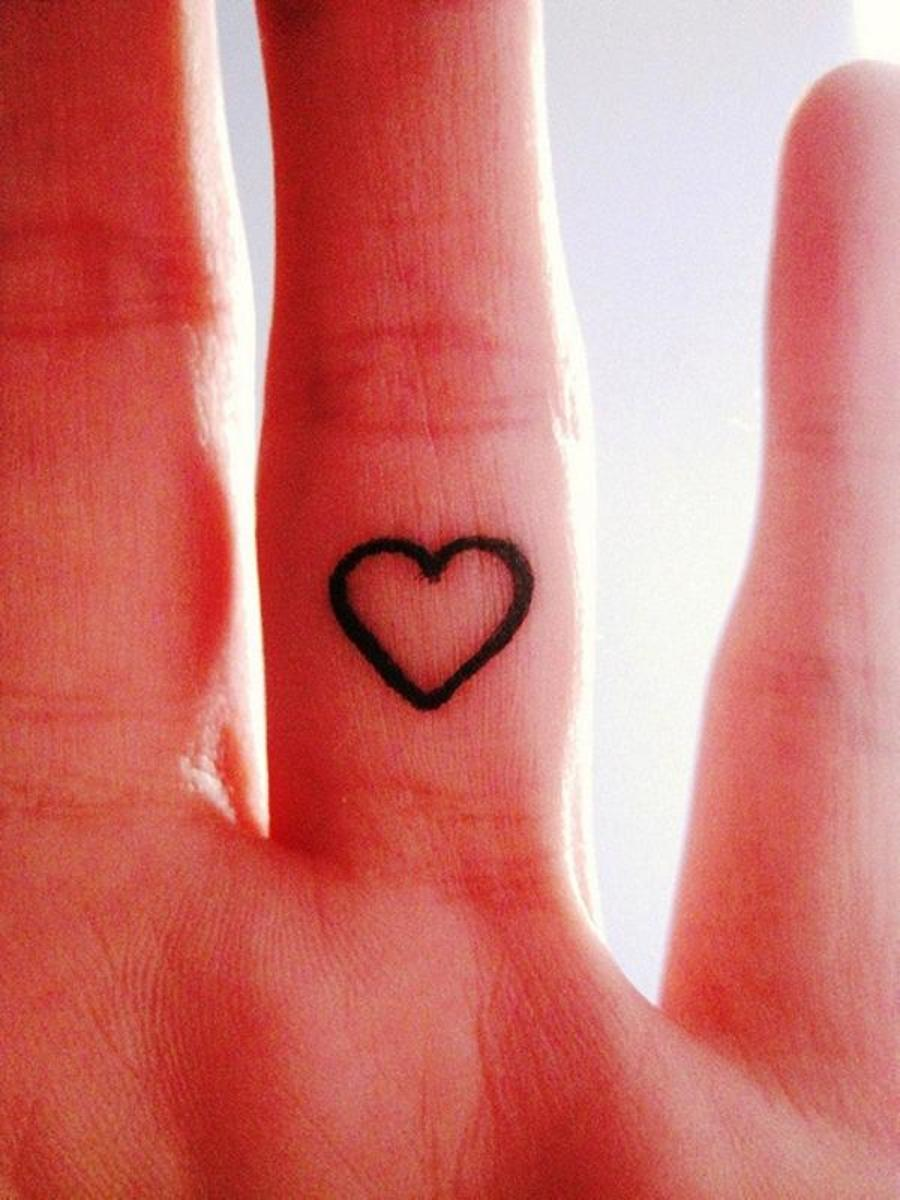 Simple heart finger tattoo. Perfection!