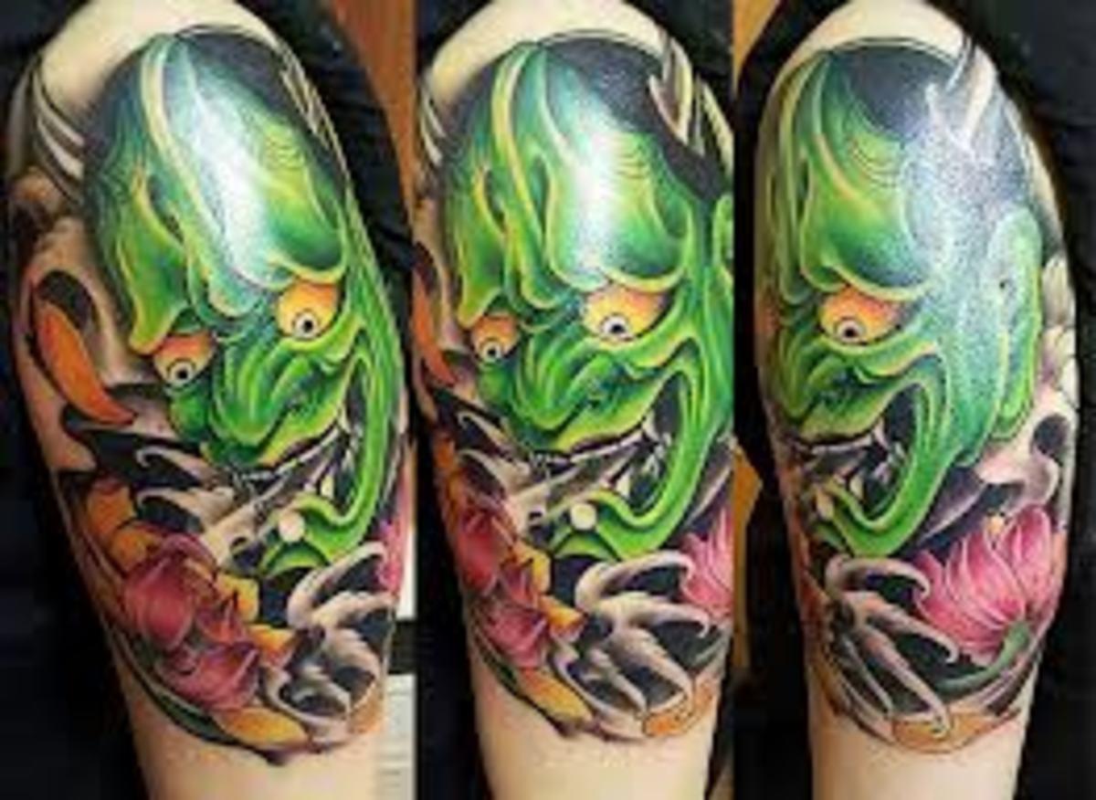Green hannya tattoo.