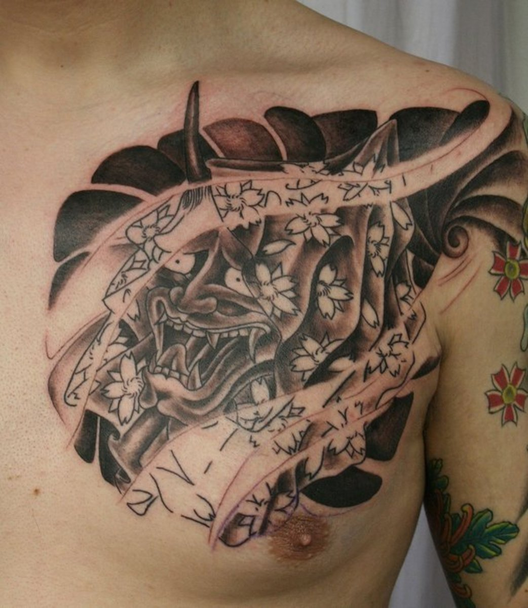 A chest tattoo of a hannya mask.