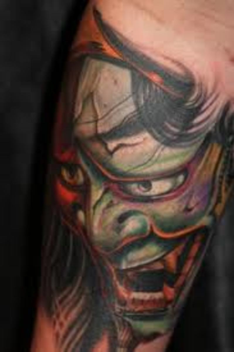 An anguished-looking green hannya tattoo.