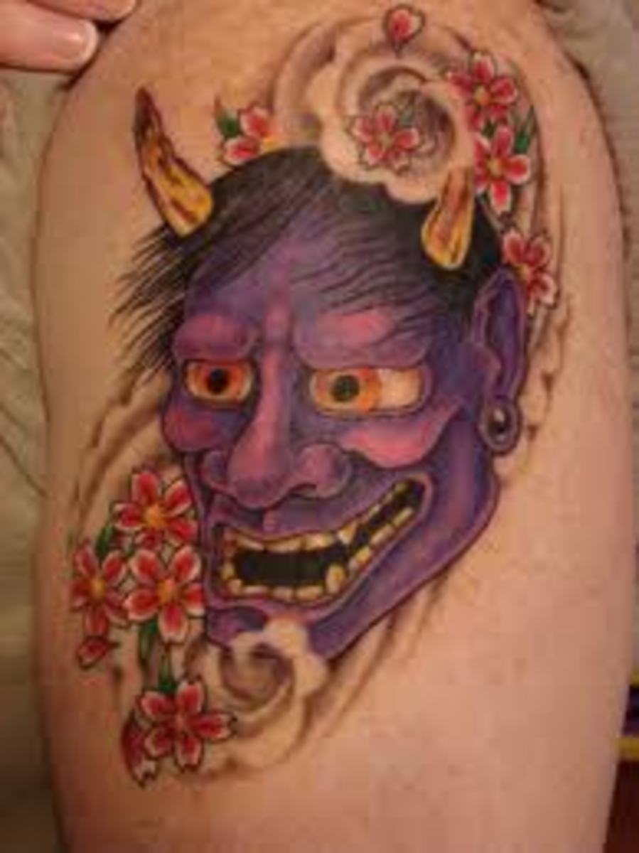 A colorful purple hannya mask tattoo with flowers.