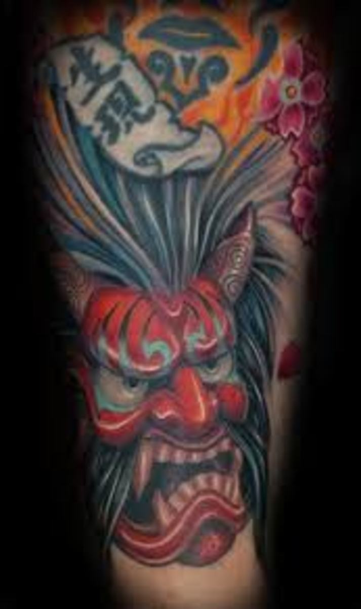 A red hannya tattoo with text.