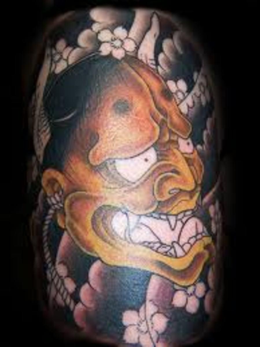An orange hannya tattoo.
