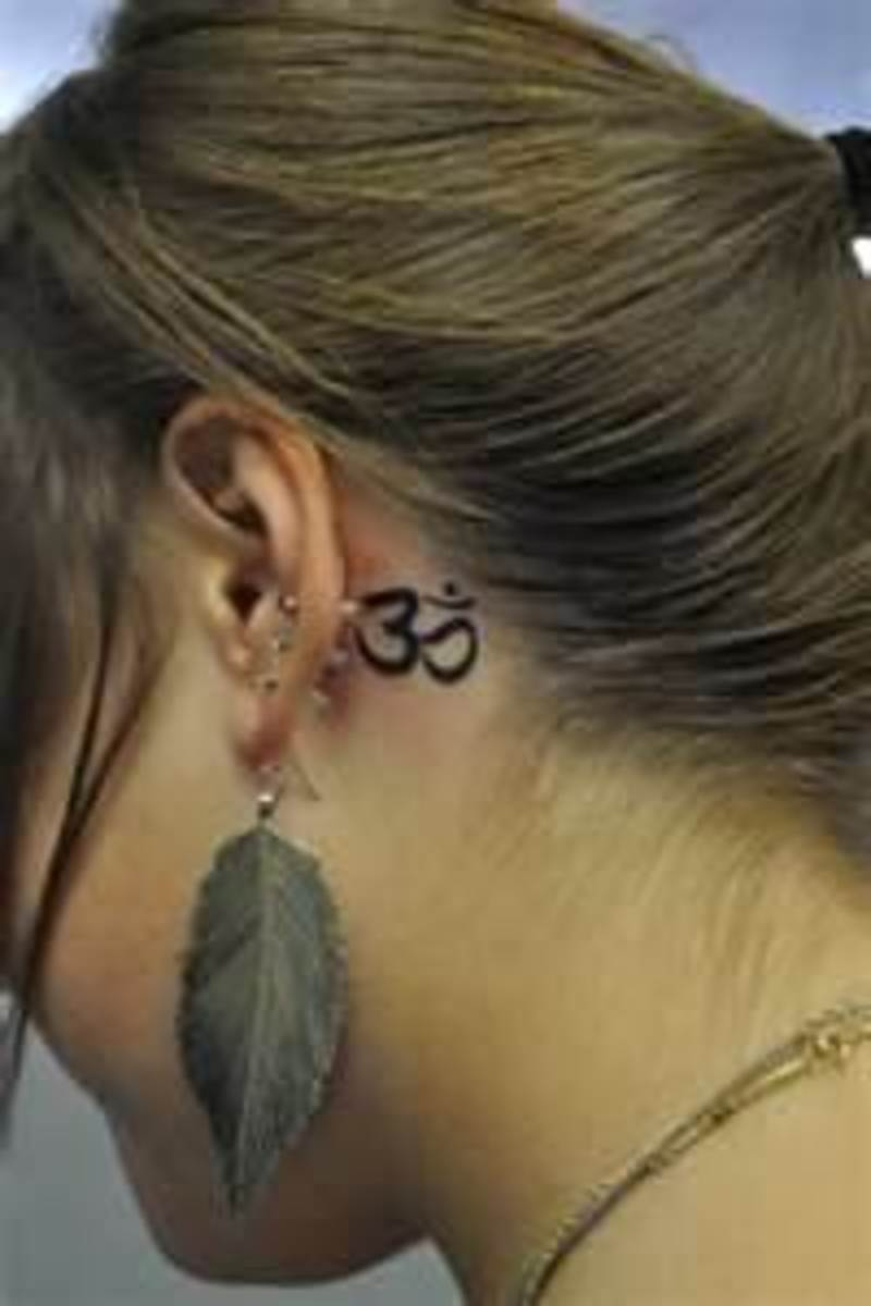 Behind the ear is a lovely, secret spot for a tiny tattoo.