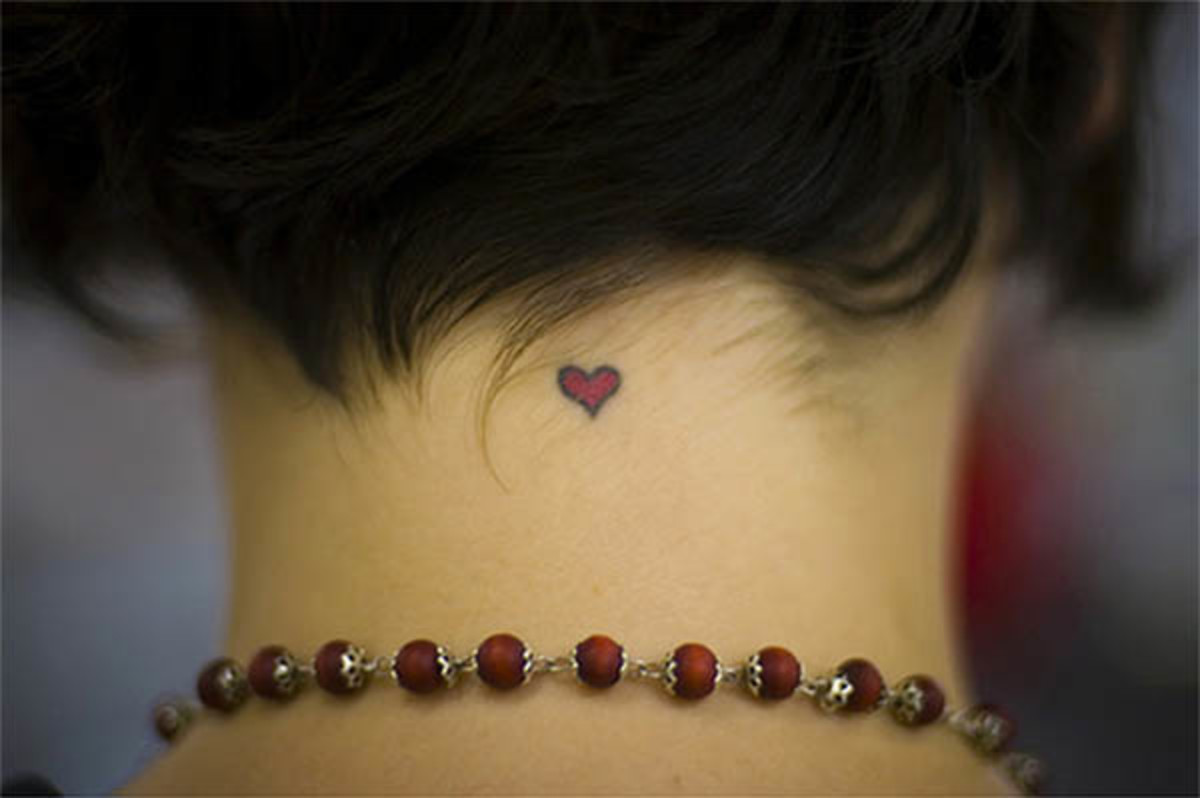A tiny tattoo can be discreet, awesome and meaningful. Explore a few tiny designs, from hearts to ladybugs.