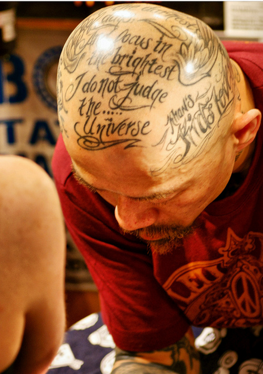 Text tattooed on scalp.