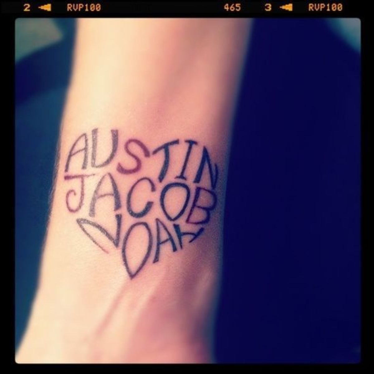 Heart-shaped text tattoo.