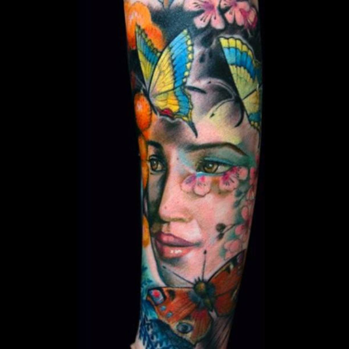 "Woman's ""sleeve"" tattoo of lady's head with butterflies"