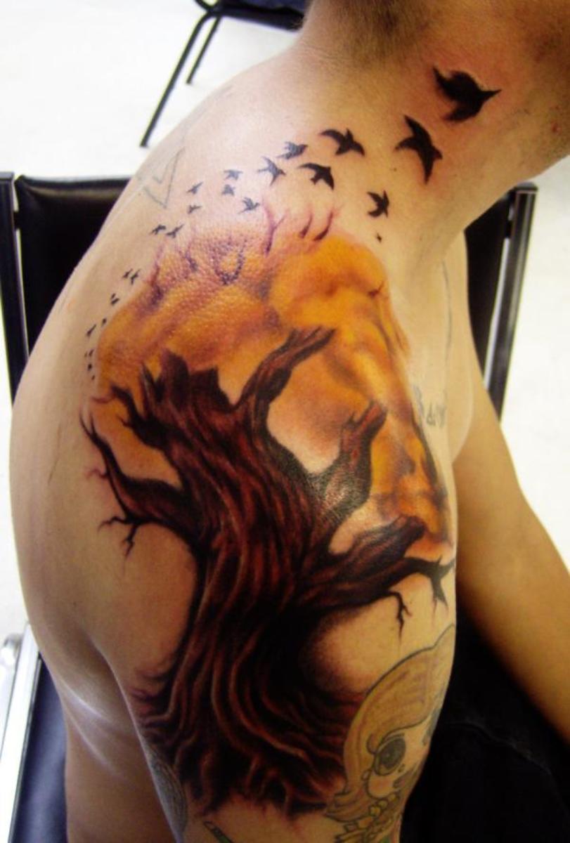 Tree tattoo with flock of birds