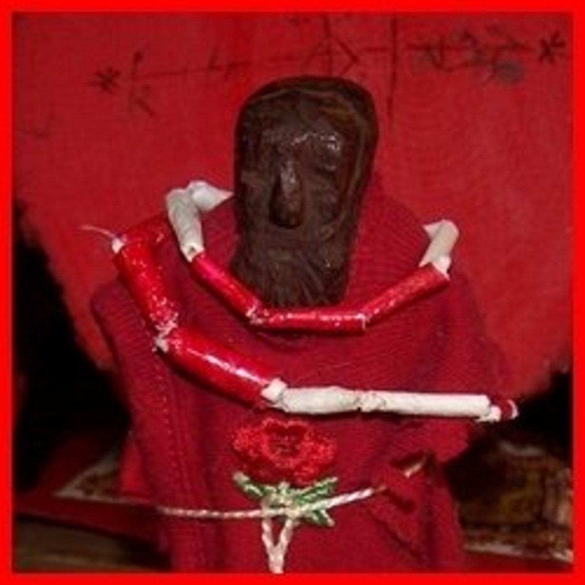 My Legba likes this tiny statue I dressed in red and made the paper bead necklace for in keeping with his Haitian colors.