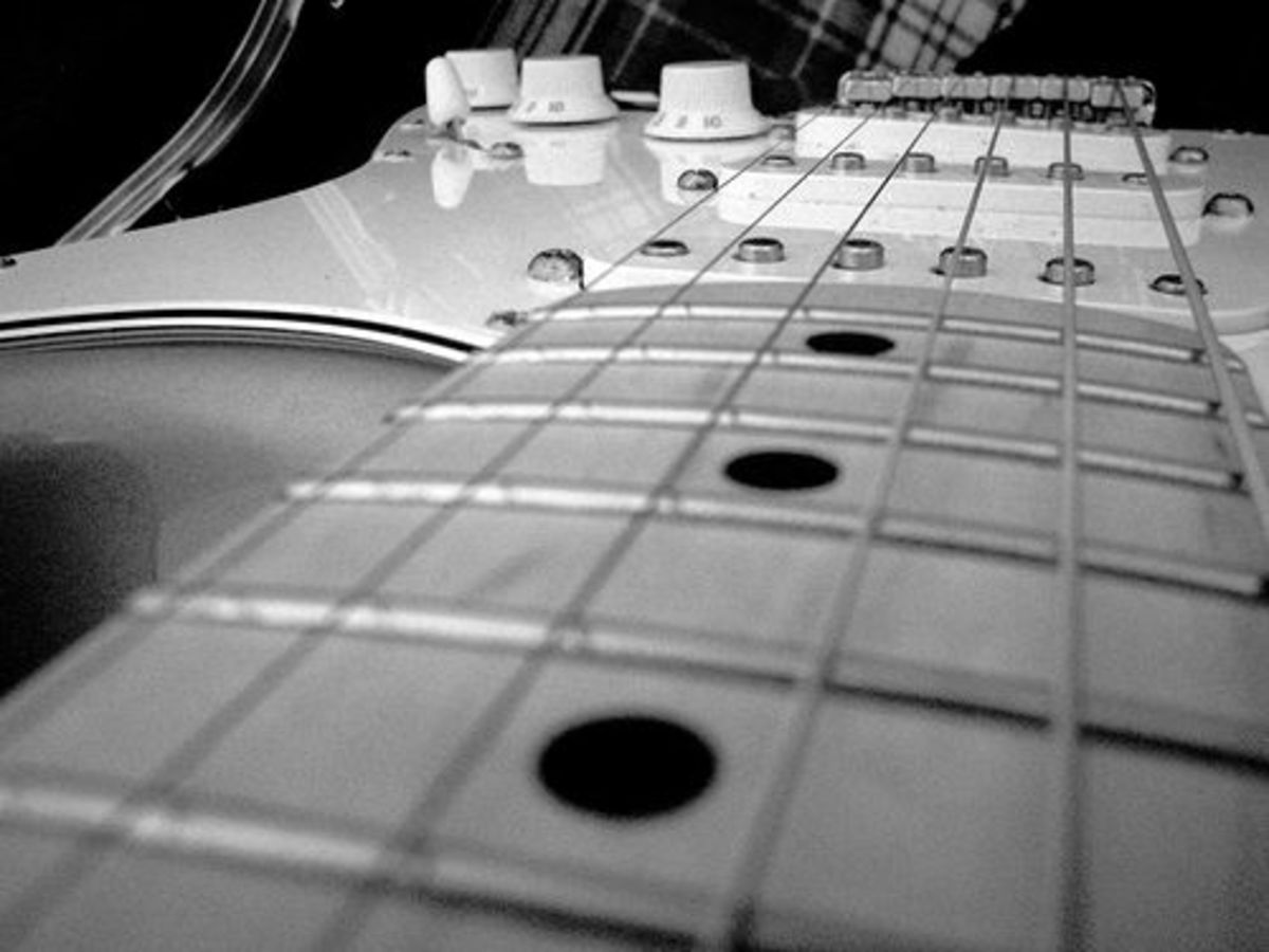 Close-up view of a Fender Stratocaster electric guitar with a maple fretboard. (Photo by Bill Bradford)