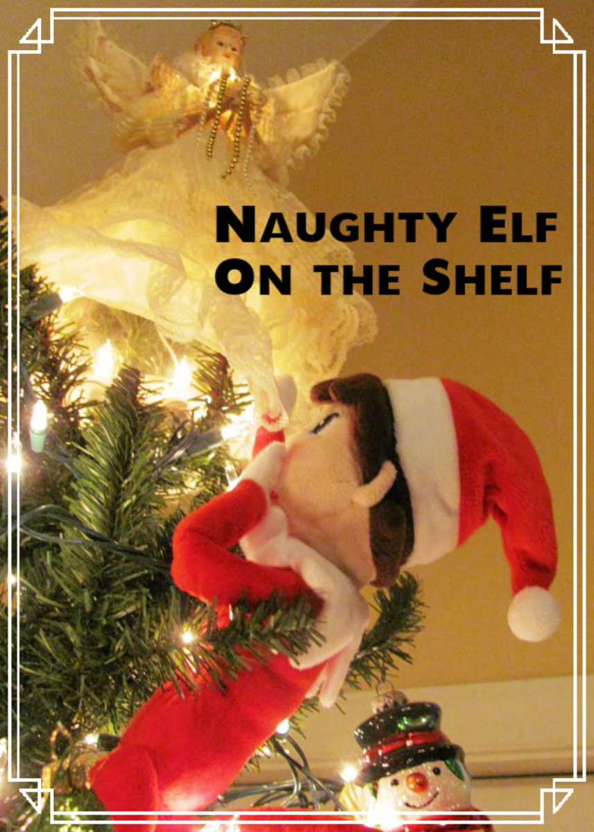 The naughty Elf On the Shelf upskirts the angel.  Now you know why the Frosty the Snowman ornament is always smiling so broadly.  (He's got the best seat in the house.)