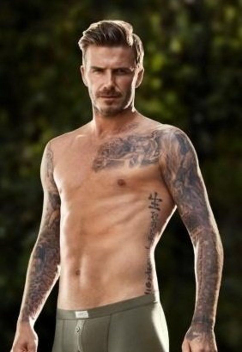 David Beckham's tattoo collection has grown up and down his arms and onto his torso over the years...