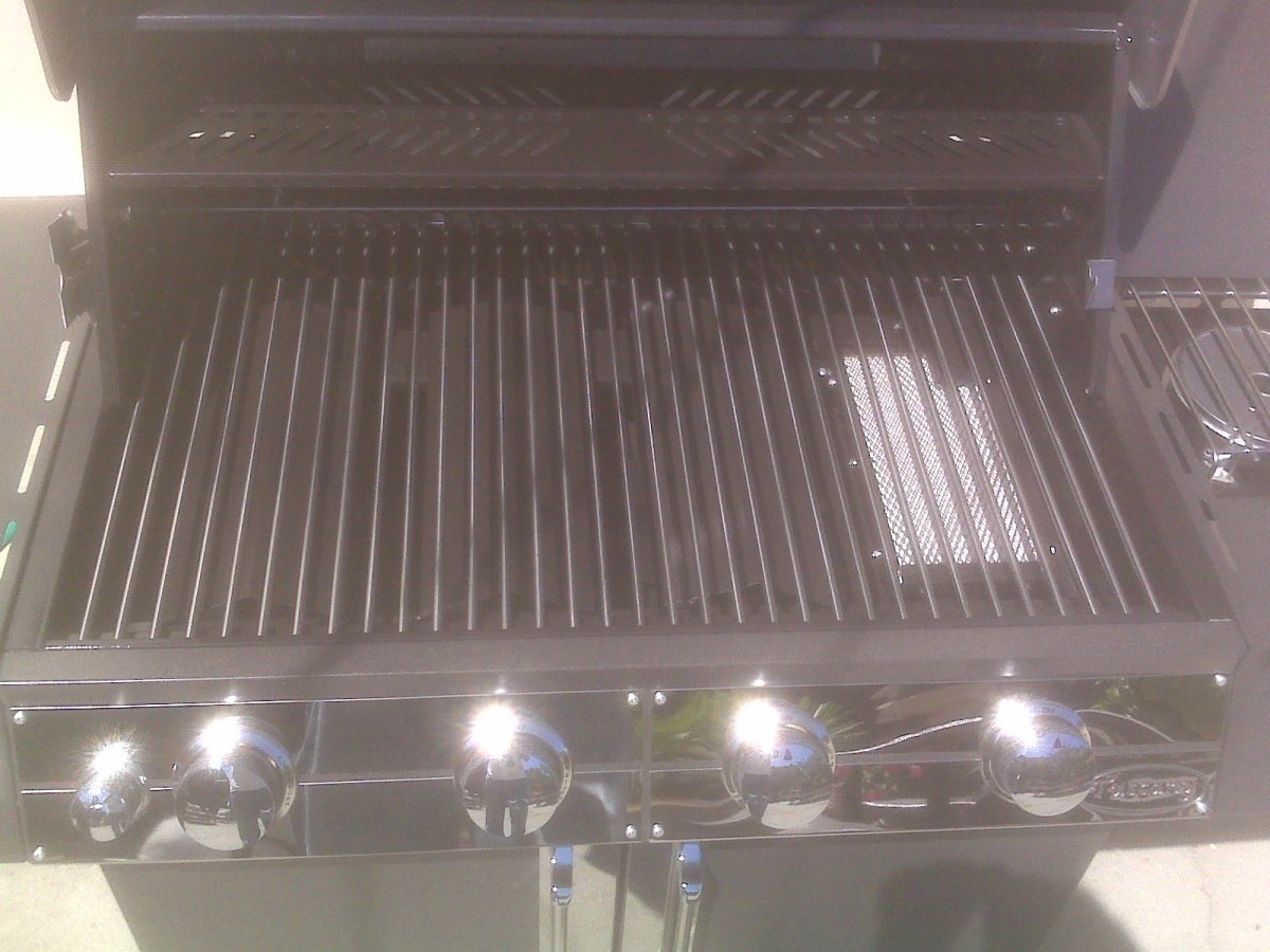 The stainless grill rolls and can be removed, but you can also see the infrared burner takes a good chunk of the grill space.