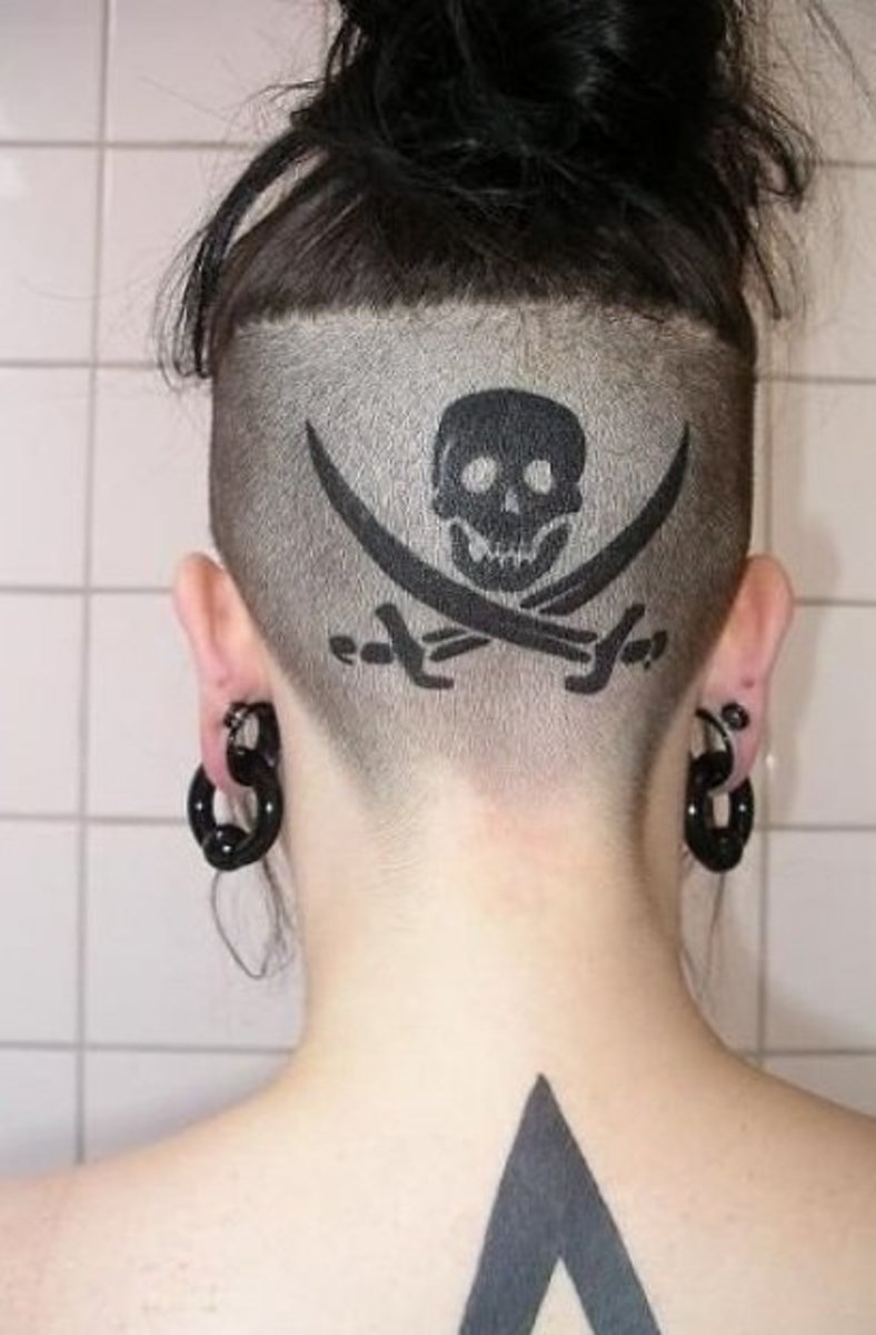 a skull and swords tattooed on the back of someone's head