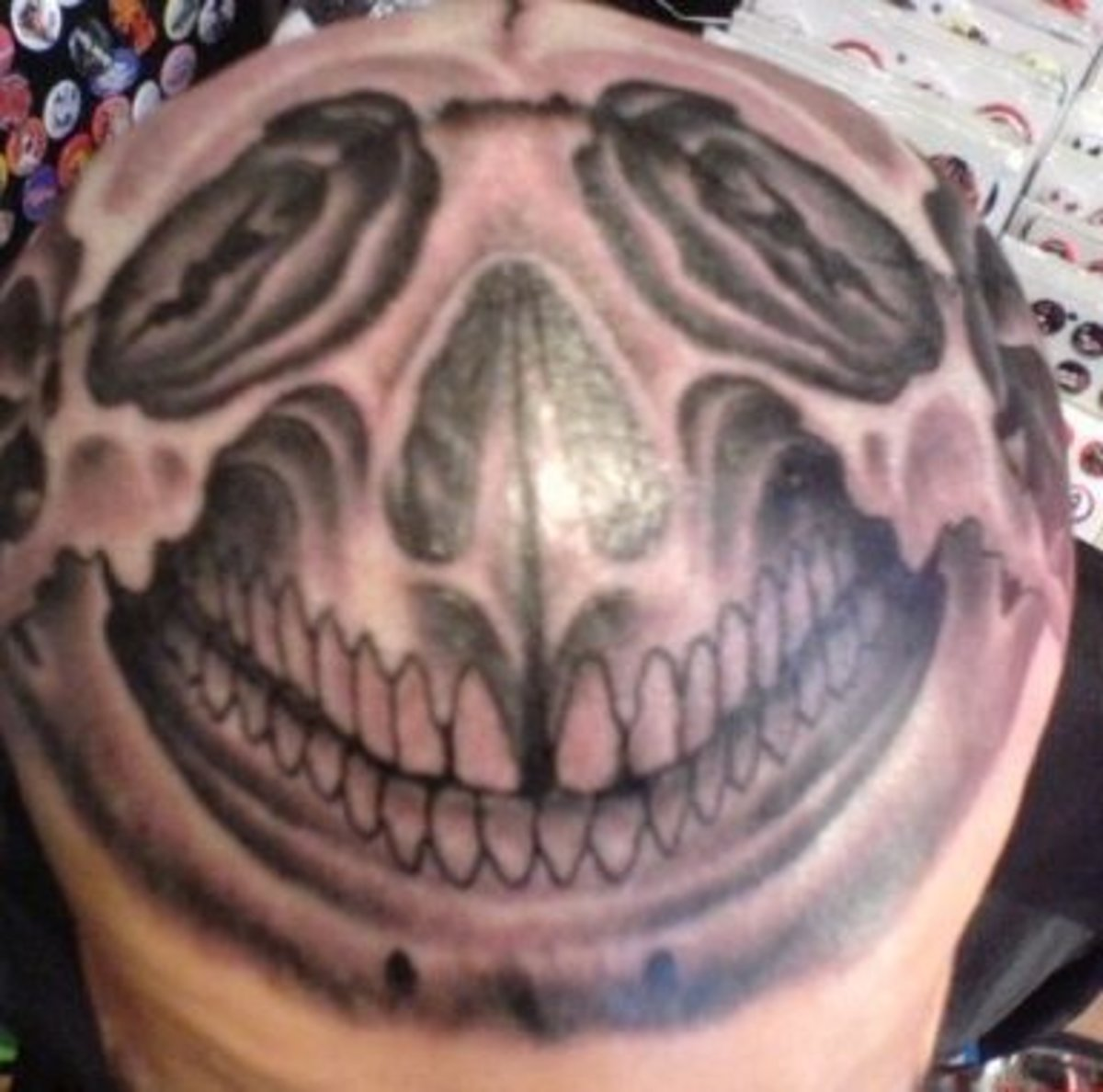 a face tattooed on a person's head