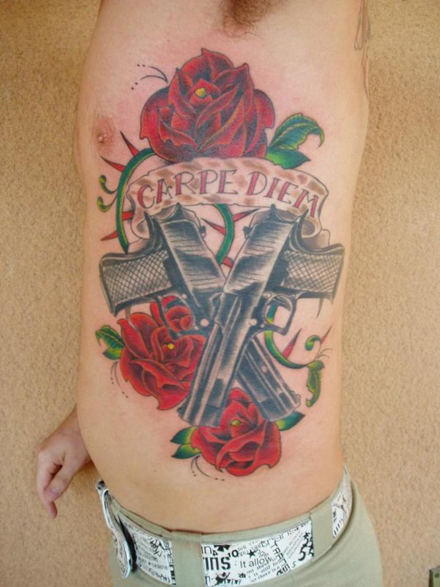 A Large Side Piece With Pistols, Roses, and a Banner