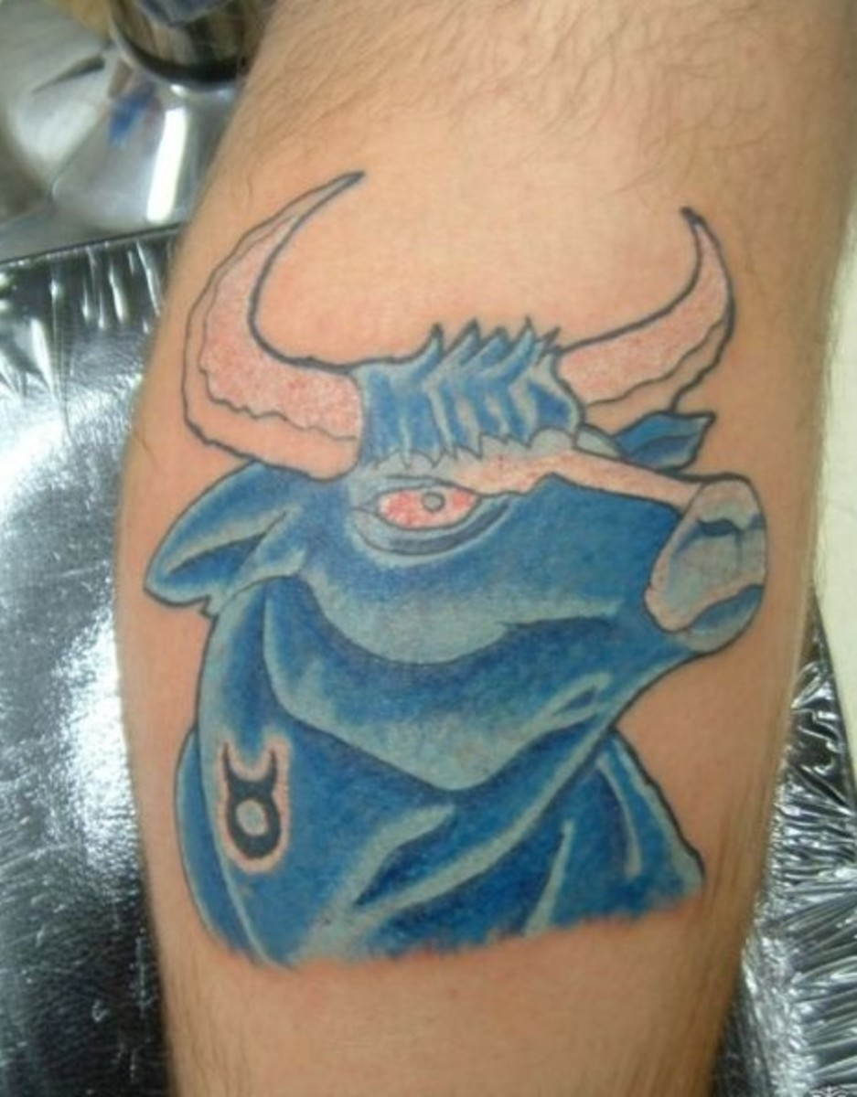 Here, the Taurus symbol is merged with a tattoo of a blue bull.
