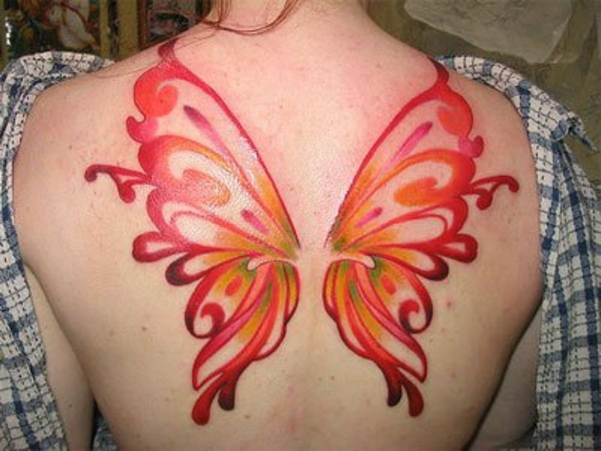 A butterfly wings tattoo on the back. (Flickr Image by spaceninja)