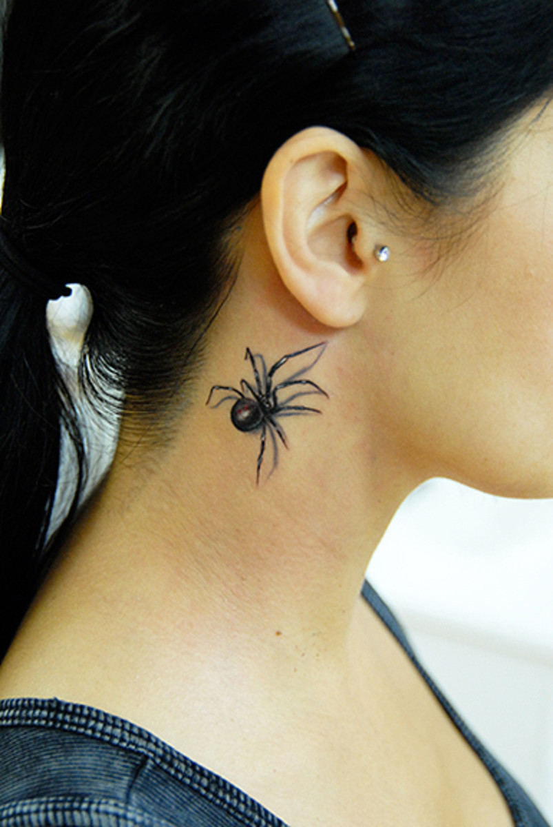 Small Black Widow Tattoo on Woman's Neck