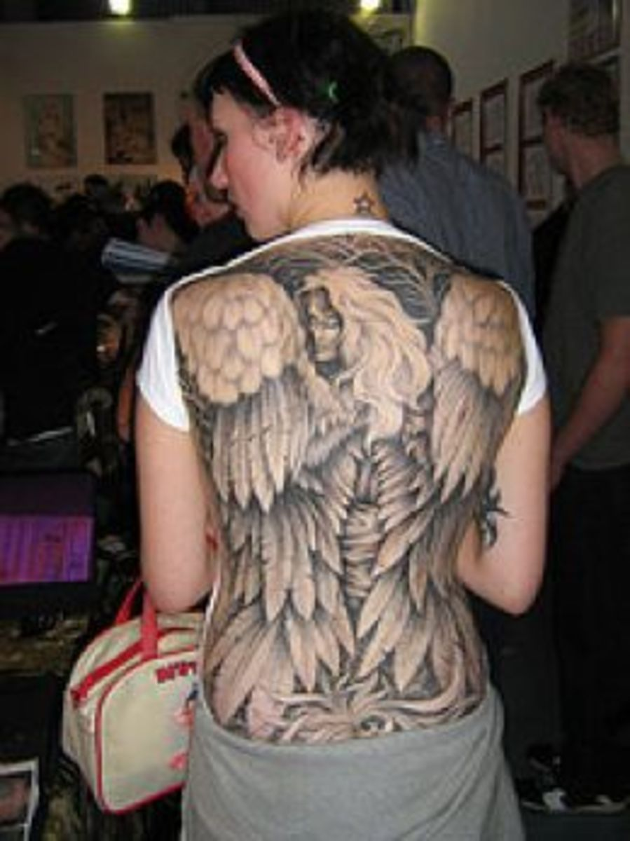 Full-back angel tattoo with large feathered wings