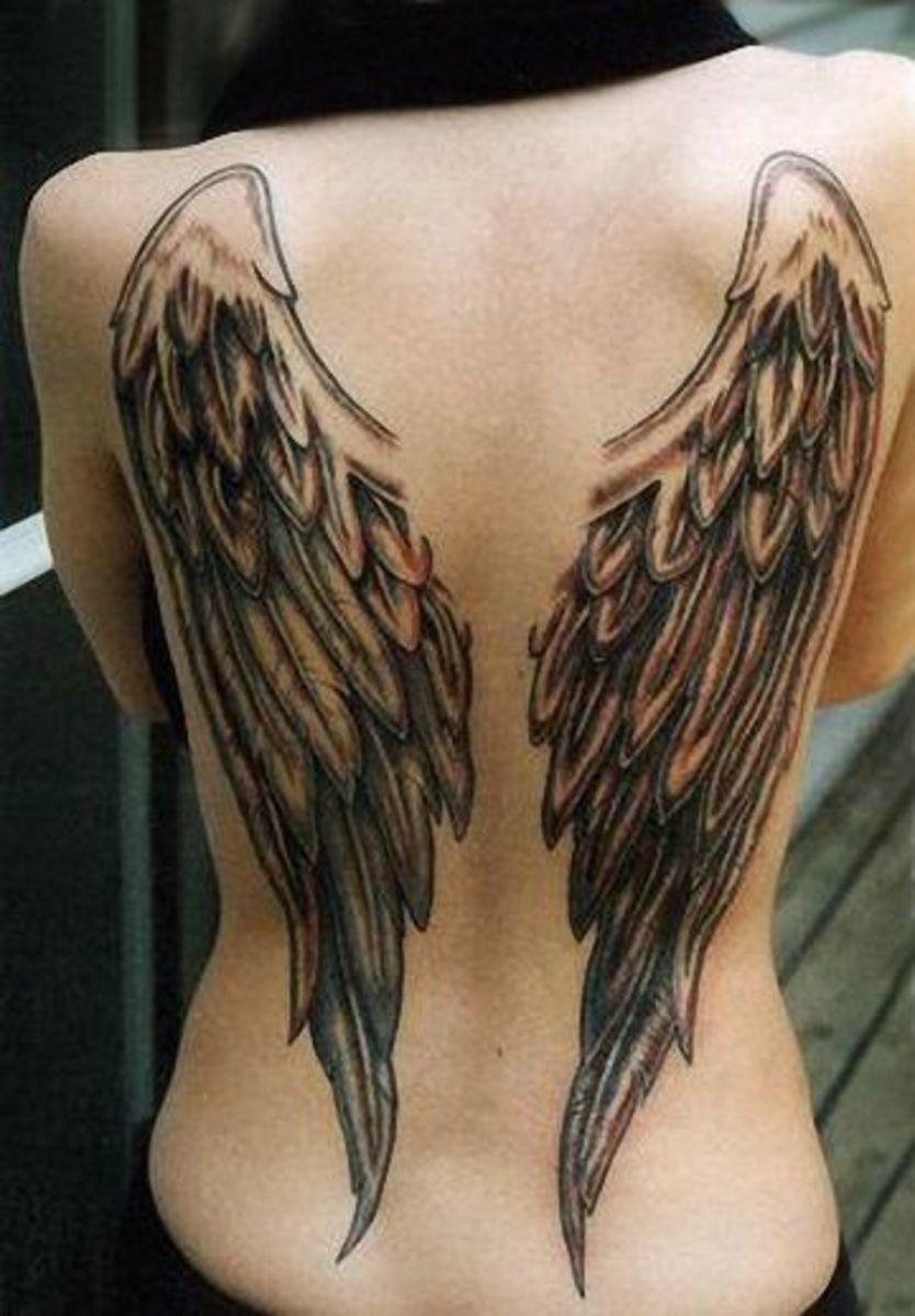 Angel wings on back tattoo