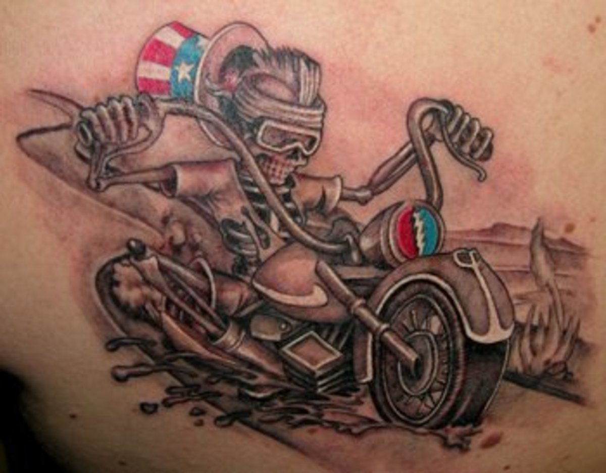 tattoo as the mud goes flying on his fast ride, and the gritting teeth