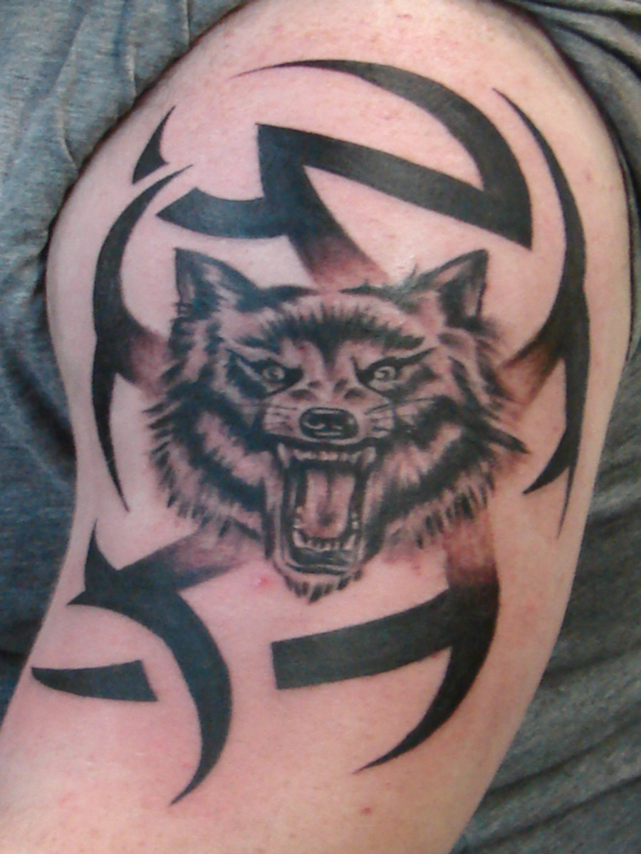 Tribal wolf tattoo design on shoulder