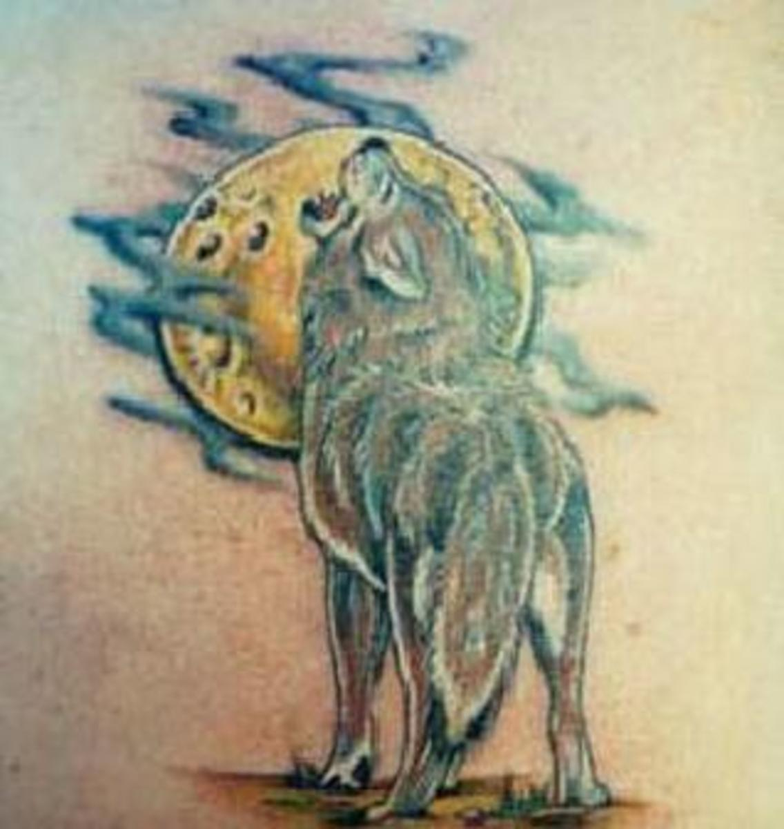 Wolf Howling at the Moon Tattoo Design