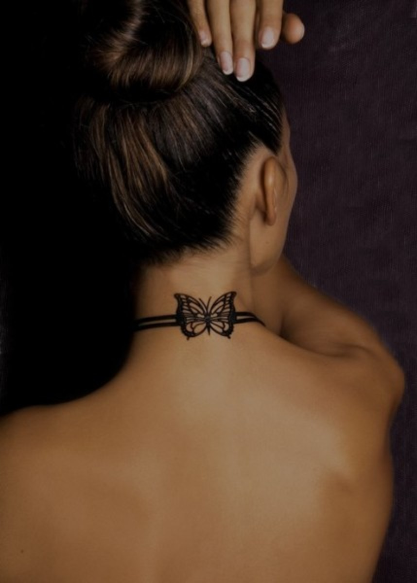 butterfly tattoos on back of neck. Butterfly tattoo on woman's neck