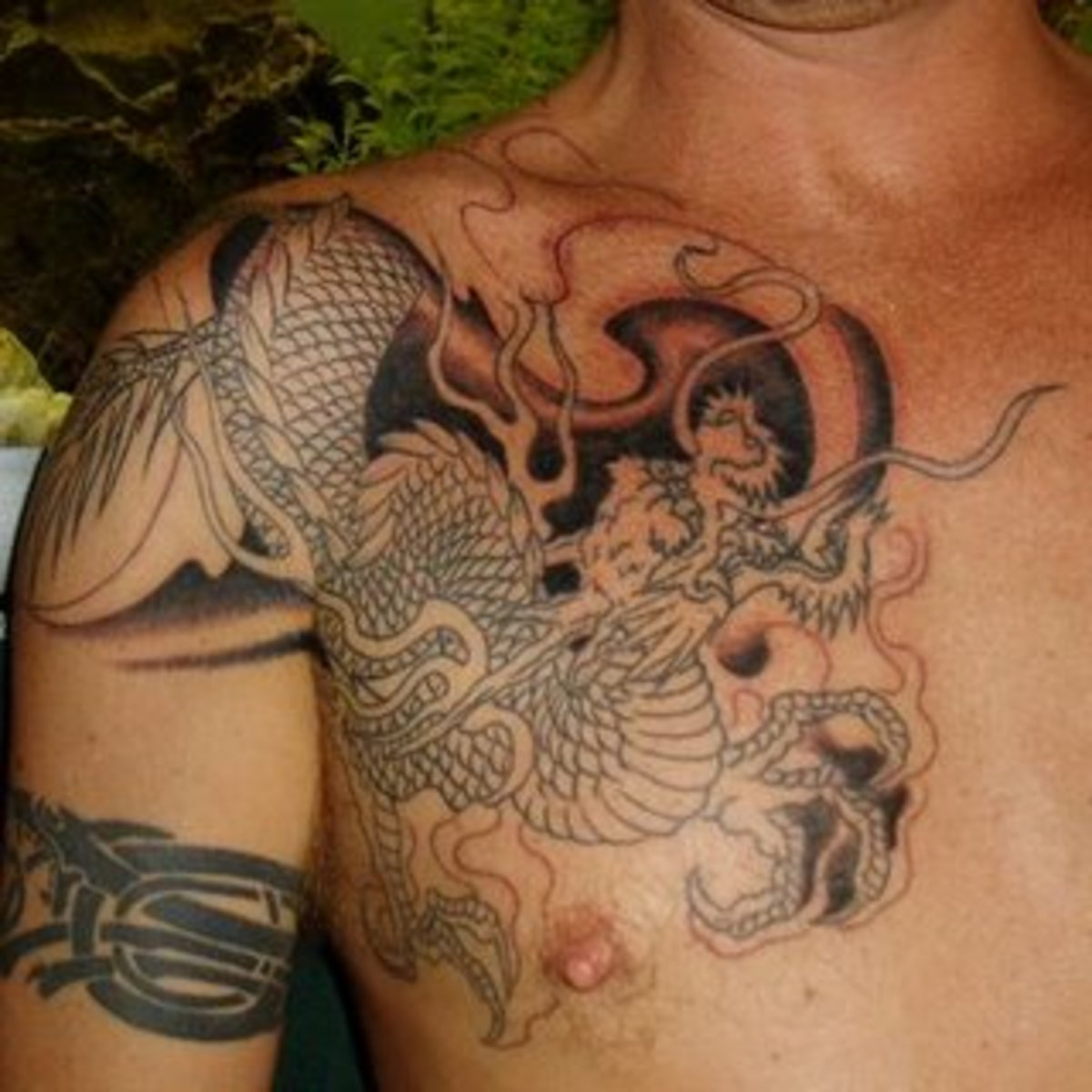 Half sleeve dragon tattoo photo