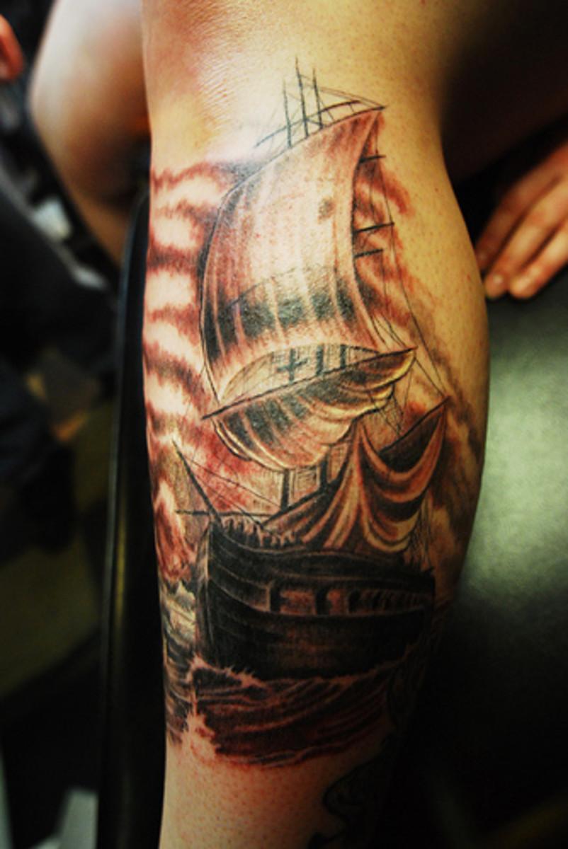 Ship tattoo on leg