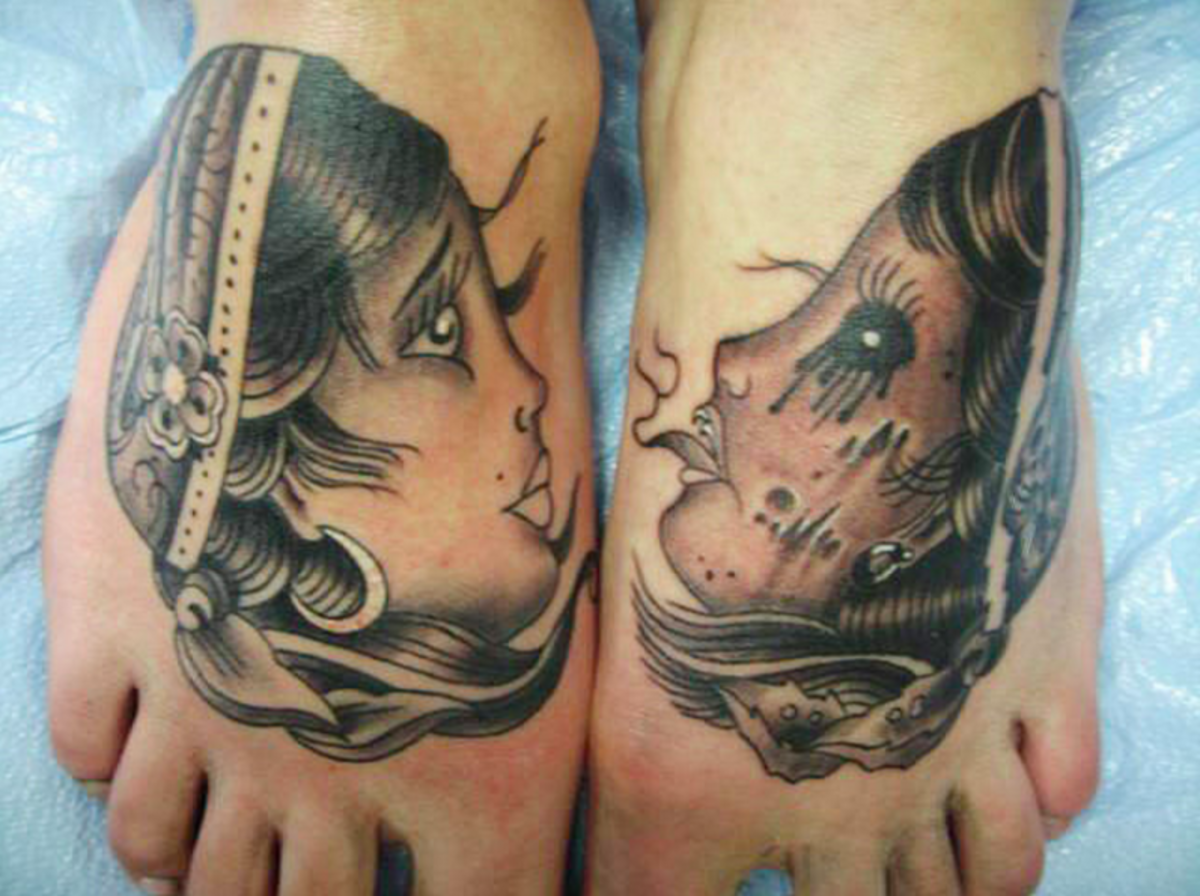 two tattoos on a person's feet
