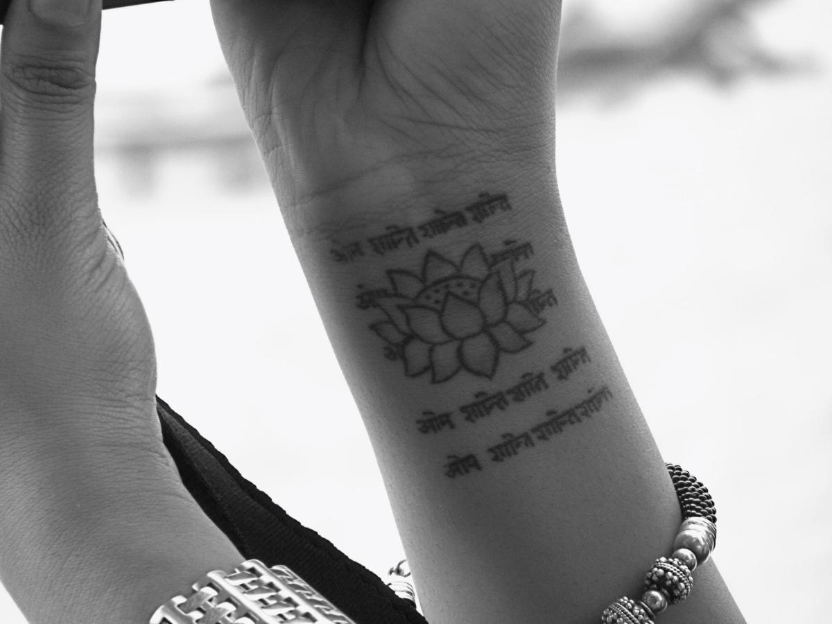 The lotus blossom with Sanskrit that says Om, Shanti Shanti (peace).